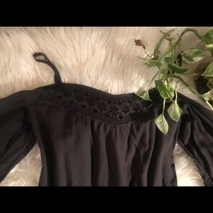 Black romper with some lace trimming